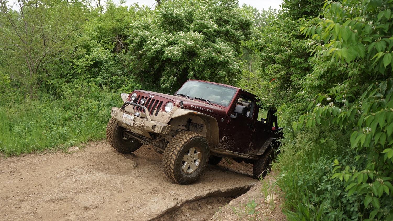Jeep wrangler jk unlimited rubicon orange trail badlands off road park